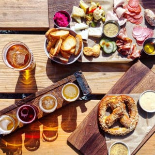 cheese board, flights and pints on town brewing's patio in charlotte
