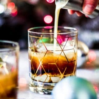pouring eggnog into a christmas white russian cocktail